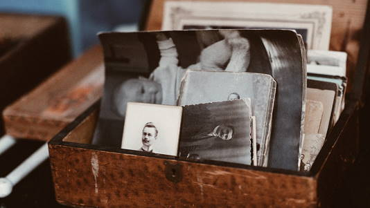 trunk with vintage black and white small photos